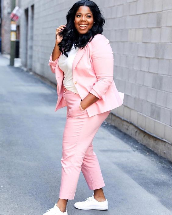 a pink suit, a white tee, white sneakers for a bright casual summer look