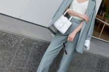 02 a slate grey pantsuit, a creamy top, creamy kitten heels and a white bag for work