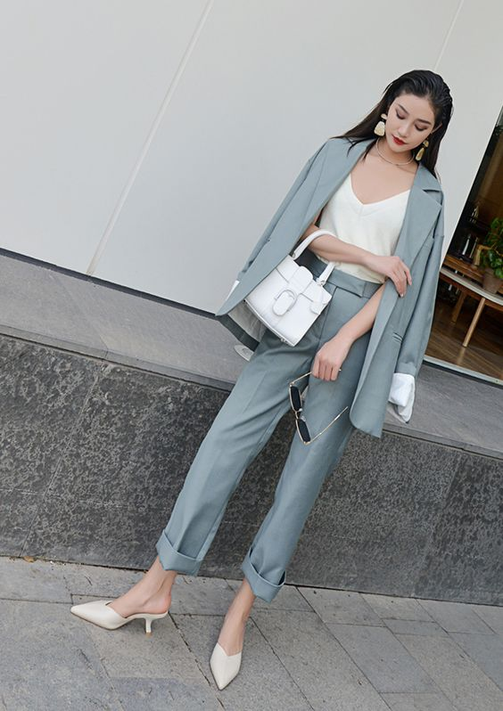 a slate grey pantsuit, a creamy top, creamy kitten heels and a white bag for work