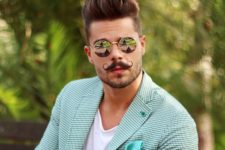 02 a textured pompadour and a waxed mustache create a dapper gentleman look
