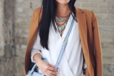 02 blue jeans, a whiet blouse, a tan blazer and a large powder blue bag for spring