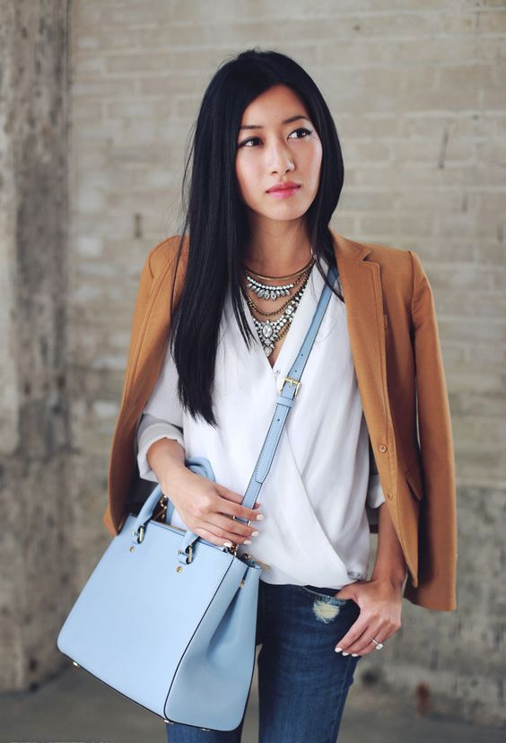 blue jeans, a whiet blouse, a tan blazer and a large powder blue bag for spring