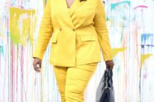 03 a bright yellow pantsuit with cropped pants, a white top, matching shoes and a black bag