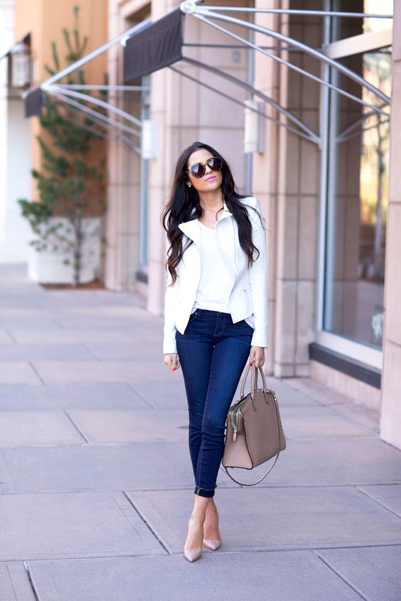 navy cuffed skinnies, a white tee, a white moto jacket, nude heels and a blush bag