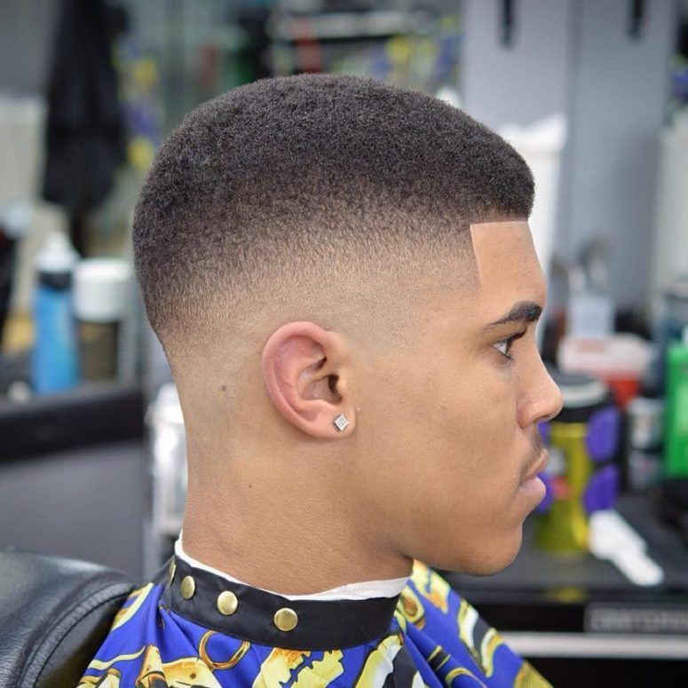 short hair and a low taper is a fresh cut with a rounded profile to rock