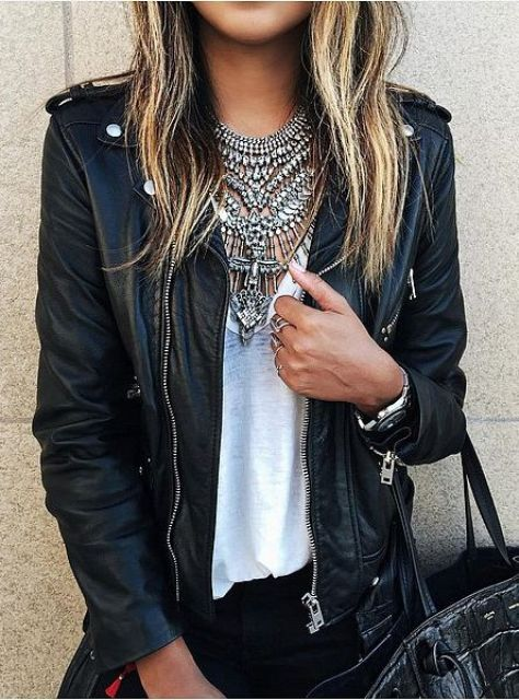 a chic look with layered statement necklaces on a top and a leather jacket for a rock feel