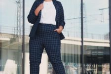 04 a navy and white windowpane suit, a white tee and white sneakers for a comfy and casual work look