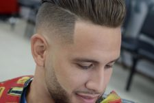 a slicked back undercut and a stylish beard and moustache is a bold and refined idea to try