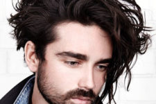 04 messy medium length hair with a texture and a beard create a very relaxed look