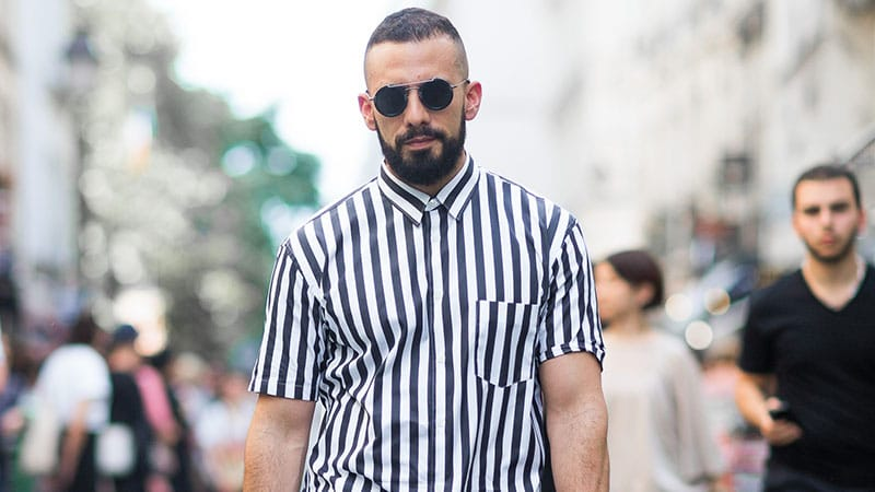 a classic high and tight haircut  features skin shaved sides and back and looks bold