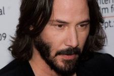 05 a long layered haircut with waves and a beard looks chic, proved by Keanu Reeves