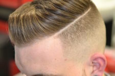05 a short pompadour and a hard part is a classic cut with a fresh twist and shorter length