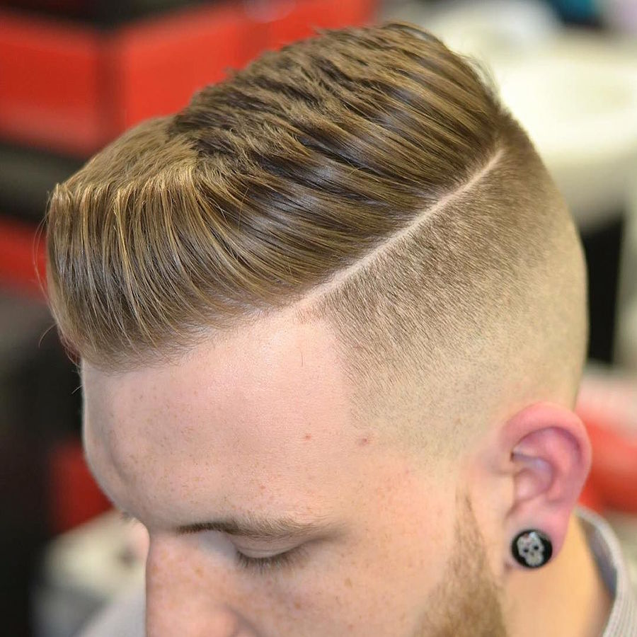 a short pompadour and a hard part is a classic cut with a fresh twist and shorter length