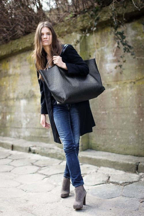 blue jeans, a blaack cardigan, grey booties and an oversized black tote
