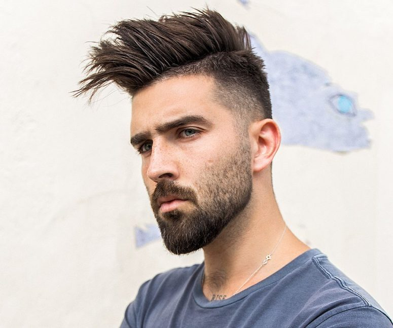 spiky hair with a fade and a full beard is a bold idea to show off your personality