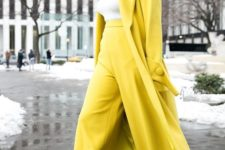 05 yellow wideleg pants, a white turtleneck, a yellow coat and snake print shoes