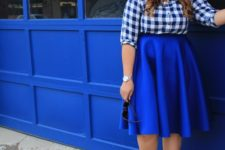 06 a blue and white checked shirt, an electric blue midi skirt and matching shoes