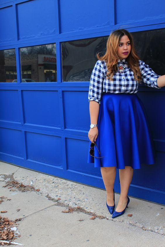 a blue and white checked shirt, an electric blue midi skirt and matching shoes