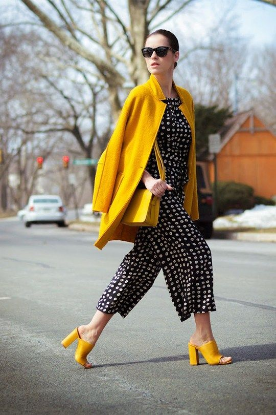 a polka dot print cropped jumpsuit, a short yellow coat and matching mules