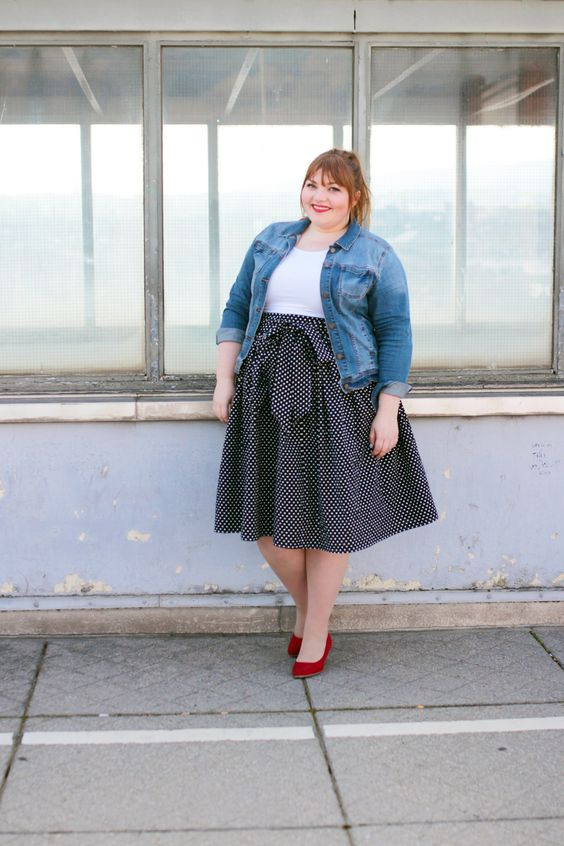 a simple and casual look with a white tee, a polka dot A line skirt, a denim jacket and red shoes