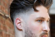 06 a textural pompadour fade with much volume slicked back looks very cool