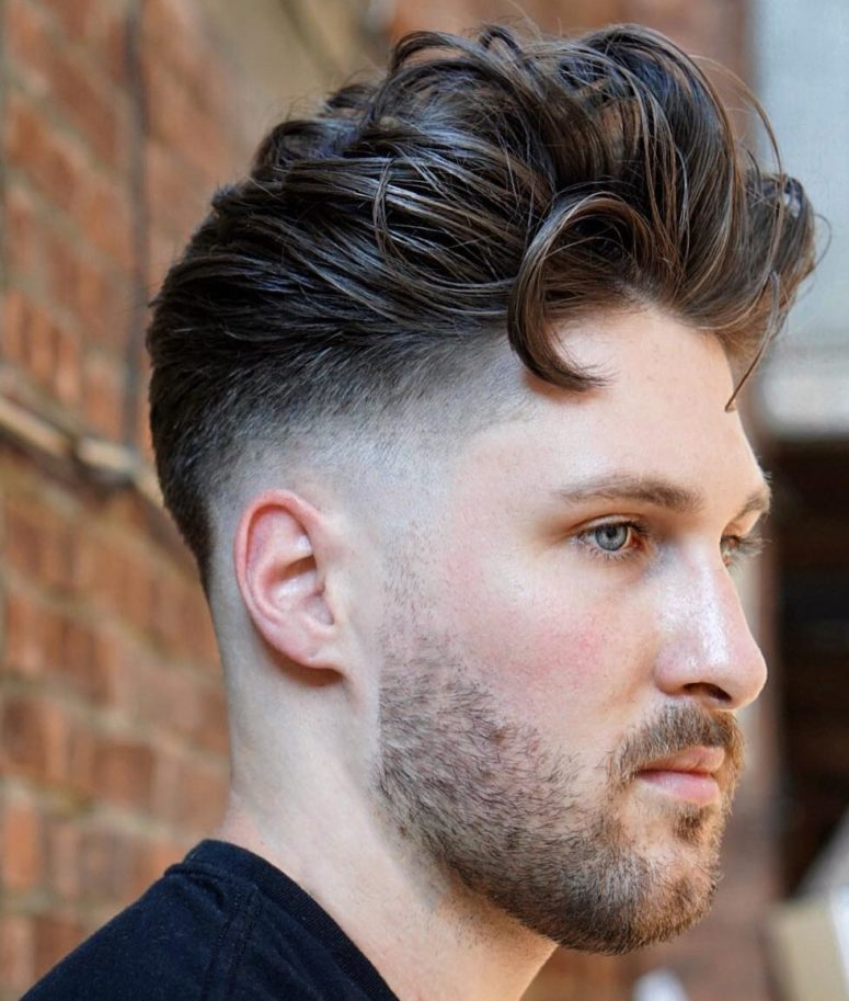 a textural pompadour fade with much volume slicked back looks very cool