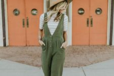 07 a boho spring look with a striped tee, an olivegreen jumpsuit, nude perforated flats and a hat