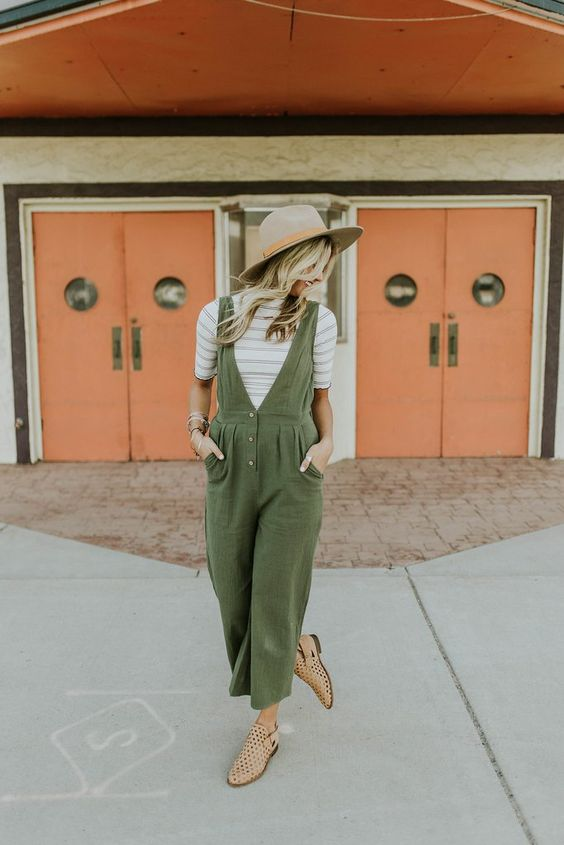 a boho spring look with a striped tee, an olivegreen jumpsuit, nude perforated flats and a hat