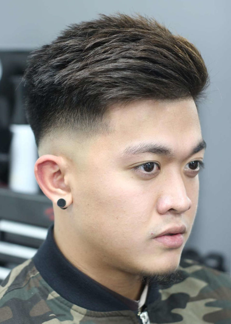 a drop fade haircut features a longer top and shorter sides that contrast
