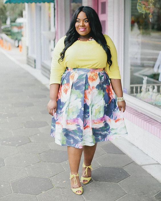 a girlish look with a yellow long sleeve top, a floral midi skirt, yellow heels with lacing