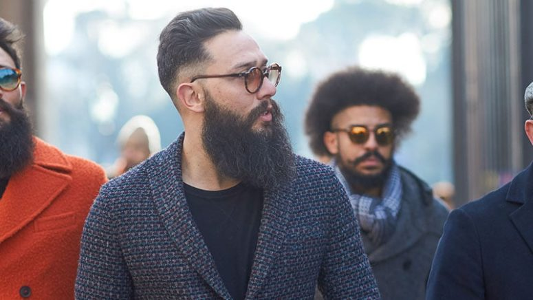 a low faded undercut plus a large beard show a bold and sharp contrast