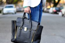 07 a white shirt, a white blazer, blue jeans, glitter heels and a black bag with zips