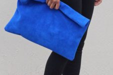 07 an electric blue oversized suede clutch will make a bright statement