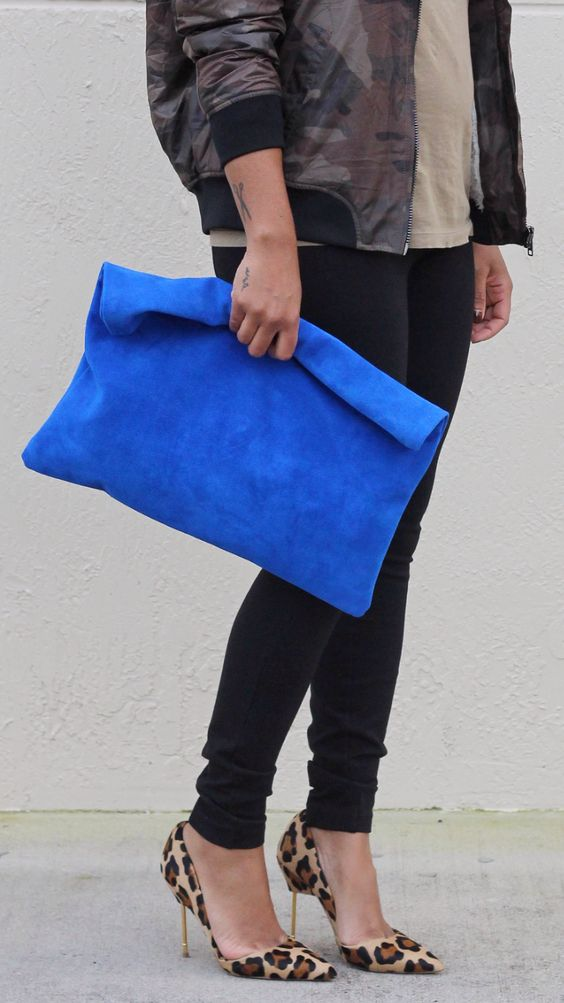 an electric blue oversized suede clutch will make a bright statement