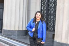 08 a black and white polka dot jumpsuit, a bright blue leather jacket, floral blue shoes and a clutch