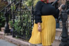 08 a black ruffle sleeve top, a yellow pleated skirt, metallic mules and statement earrings