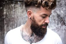 a curly hairstyle for a hipster man