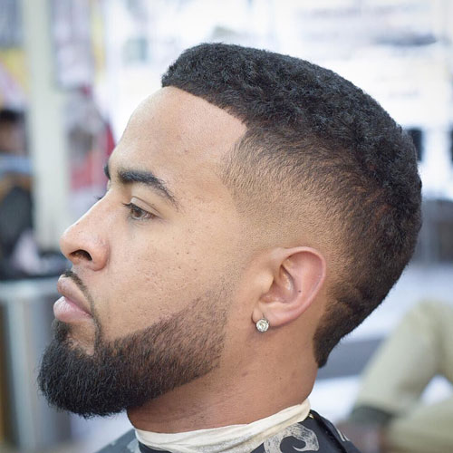 a high drop fade, a crew cut and a beard are a chic modern combo with a laconic feel