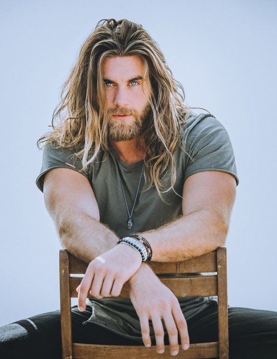 a long textural hairstyle and a beard is a beautiful and very relaxed idea for a modern man