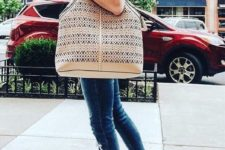 08 a striped shirt, blue skinnies, brown heels and a large boho inspired bag