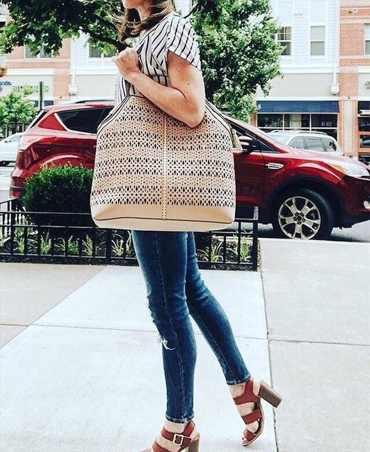 a striped shirt, blue skinnies, brown heels and a large boho inspired bag