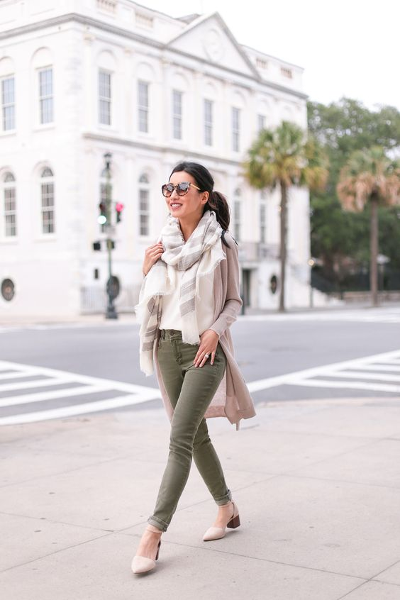olive jeans, a white tee, a striped scarf, a nude cardigan and creamy shoes