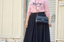 09 a casual look with a pink top, a black midi skirt, black heels and a crossbody