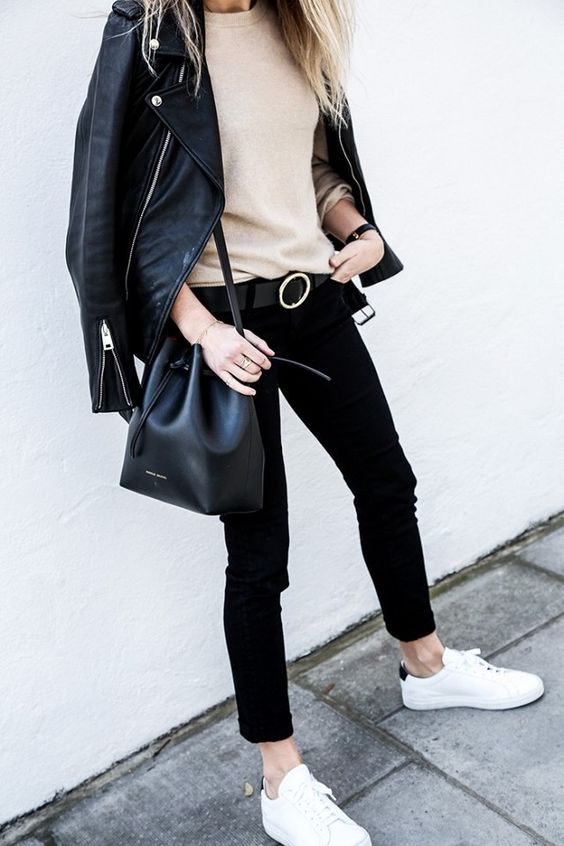 a casual look with black skinnies, a tan top, a black leather jacket, white sneakers and a black bucket bag