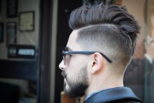 09 a cool messy pompadour undercut haircut styled up and a beard for a statement look