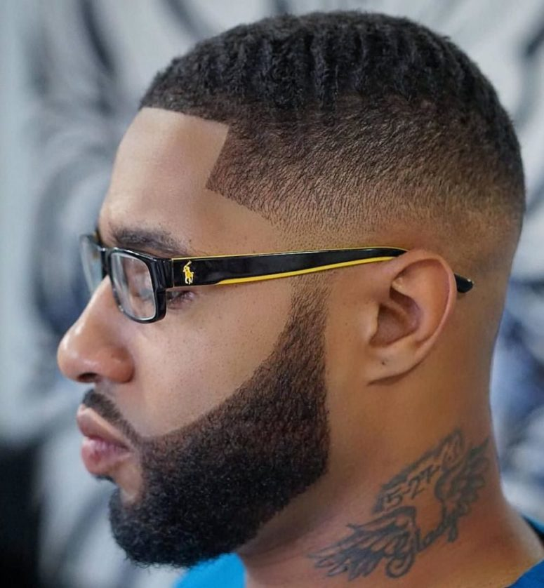 waves and a low blurry fade is a stylish haircut to try, and a beard is perfectly shaped