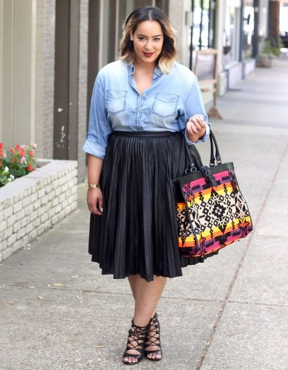 a chambray shirt, a black pleated midi skirt, lace up shoes and a colorful bag