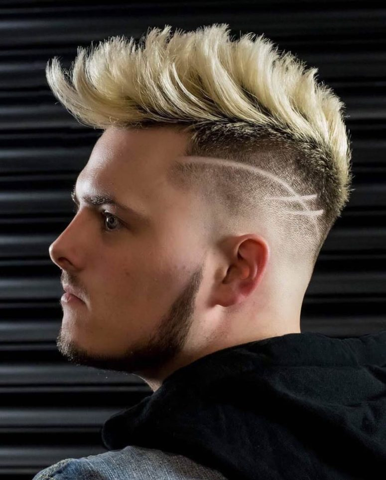 a dyed faux hawk with a disconnected design looks very eye-catchy thanks to the lines and color
