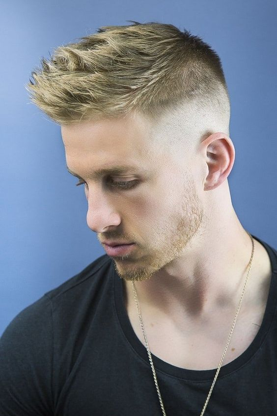 a high and tight haircut with a spiked top and fade sides is a fresh take on classics