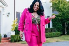 10 a hot pink pantsuit with a colorful printed top, white platform shoes and a white bag